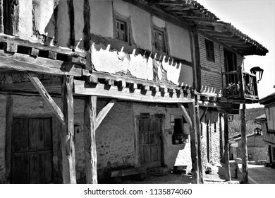 street, arcades, typical buildings, Calatañazor, Soria, Spain, series of black and white artistic photographs