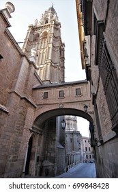 Street arch of palace with the tower of gothic cathedral of Toledo, Spain, toledo monuments,