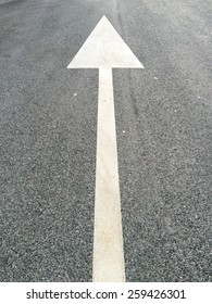 Street arrow sign on the ground