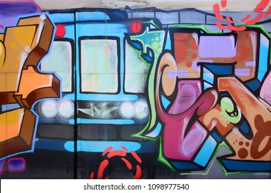 Street art. Abstract background image of a fragment of a colored graffiti painting in fashionable colors.