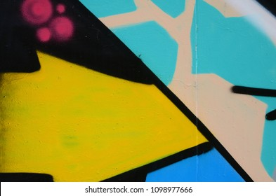 Street art. Abstract background image of a fragment of a colored graffiti painting in blue tones.