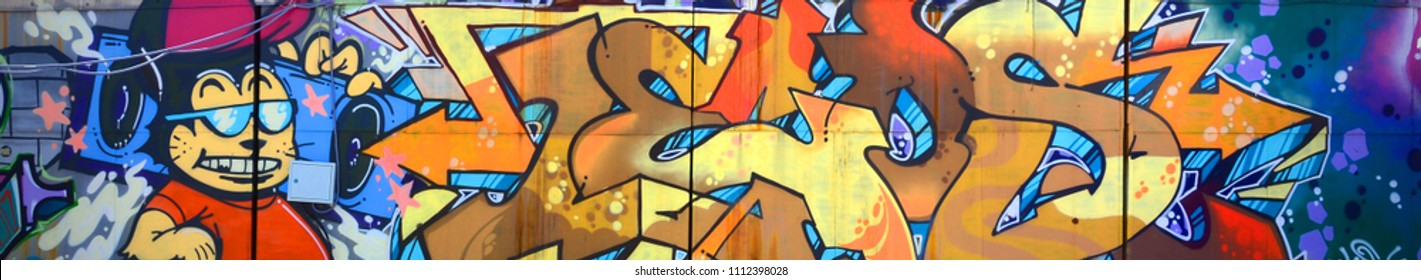 Street art. Abstract background image of a full completed graffiti painting in beige and orange tones with cartoon character