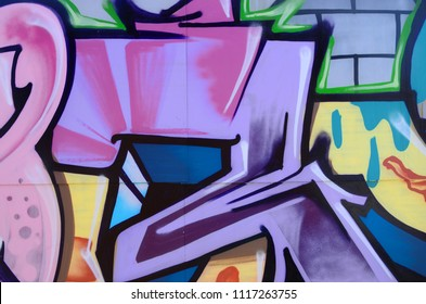 Street art. Abstract background image of a fragment of a colored graffiti painting in cosmic blue and violet tones