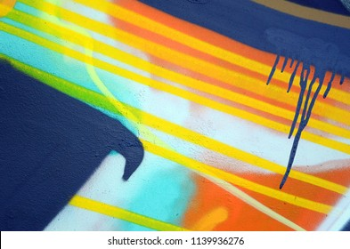 Street art. Abstract background image of a fragment of a colored graffiti painting in khaki green and orange tones