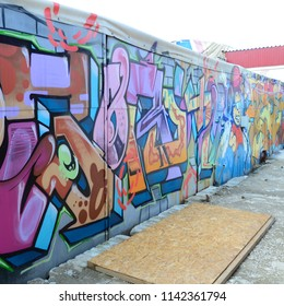 Street art. Abstract background image of a full completed graffiti painting in many fashionable colors and tones