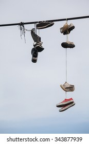 street art against blue sky/old shoes hanging on the wire - life change