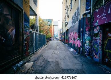 Street art in Graffiti Alley, in the Fashion District of Toronto, Ontario.