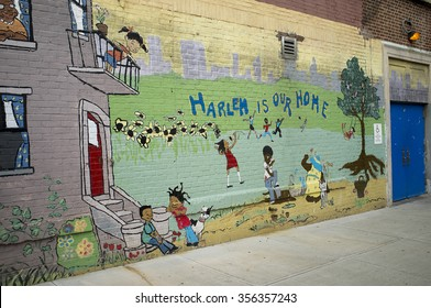 STREET ART A PAINTING ON A SCHOOL WALL IN HARLEM NEW YORK - CIRCA 2014 -  Harlem is our Home a painting on a school wall in Harlem New York USA
