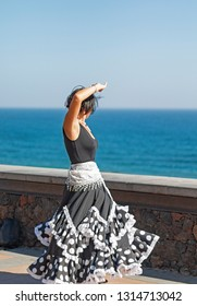 A street artist dancing Flamenco. Not recognizable person.