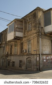 Street in Baku with old shabby house