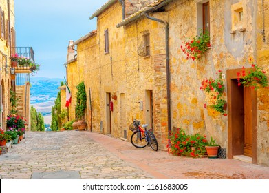 A street in the beautiful little village of San Gimignano with a view of the Tuscan valley. Italy. Europe