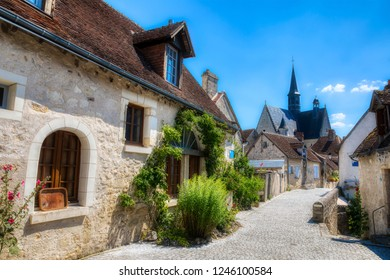 Street in the Beautiful Village of Montresor, Loire, France, with St John the Baptist Collegiate Church