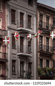 Street in Bilbao, Basque Country, Spain, buildings with party flags on the balconies