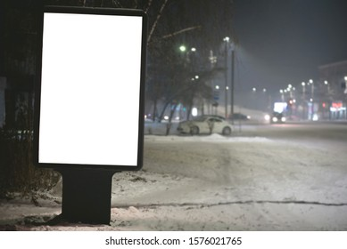 Street billboard with copy space in winter night.