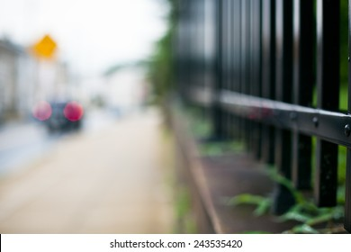 Street with black fence