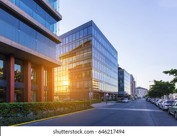 Street in Budapest with modern office buildings, sun reflections on glass windows