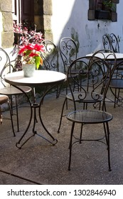 Street cafe with metal tables and chairs. arcelona