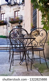 Street cafe with metal tables and chairs in Barcelona