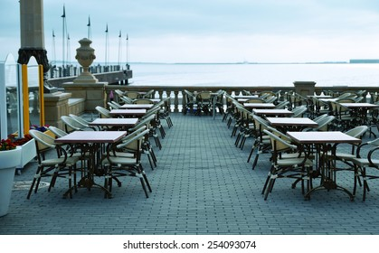 Street cafe on the background of the Caspian Sea, toned photo