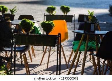Street cafe terrace with wooden tables and chairs