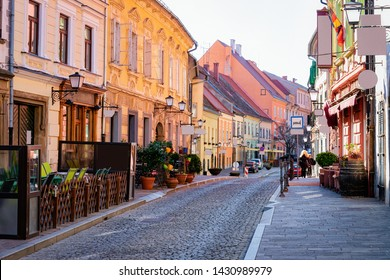 Street cafes with tables and chairs in Ptuj old town center in Slovenia. Architecture and restaurants in Slovenija. Travel
