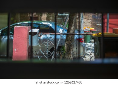 Street car parking view from inside house passed by window