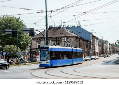 Street of the city of Krakow. The old Town. Public transport on the streets. Trams and buses. Polesha. City center.
