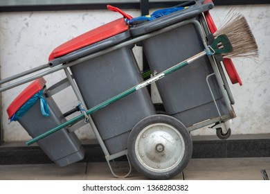street cleaner barrow with brush and litter