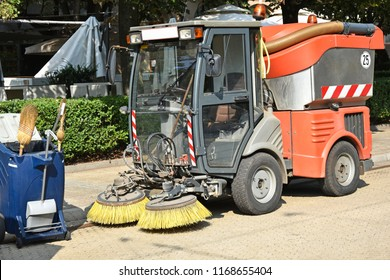 Street cleaner vehicle and garbage can on the road
