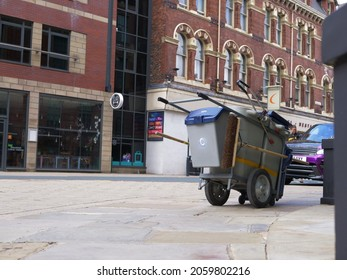 Street cleaning cart in city road wide shot Leeds West Yorkshire UK 25th July 2021