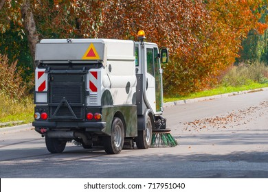 street cleaning machine on the background of the autumn park