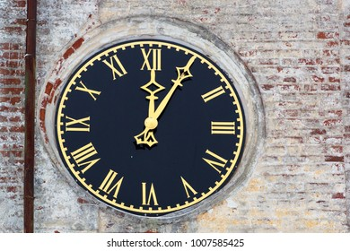 Street clock on a brick building