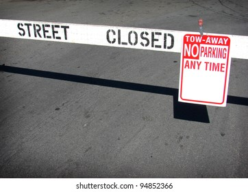 street closed no parking sign and barricade