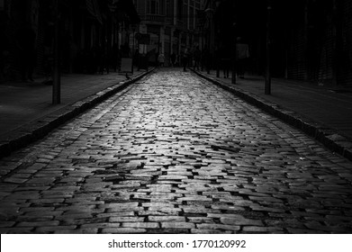 street with cobblestone pattern in black and white