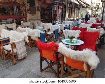 street coffee shop tables and chairs with warm cloth  in Kalari street Ioannina city Greece