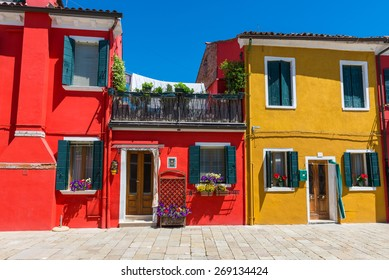 Street with colorful buildings in Burano island, Venice