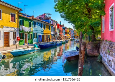 Street with colorful buildings and canal in Burano island, Venice, Italy. Architecture and landmarks of Venice, Venice postcard