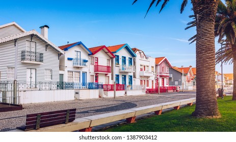 Street with colorful houses in Costa Nova, Aveiro, Portugal. Street with striped houses, Costa Nova, Aveiro, Portugal. Facades of colorful houses in Costa Nova, Aveiro, Portugal.
