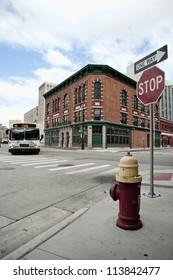 Street corner in Detroit Michigan USA. A city bus in rounding the corner.
