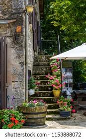 Street corner in La Couvertoirade fortified town in Larzac region, France departement Aveyron