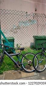 Street corner landscape Bicycle fence Recycle bin