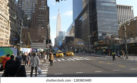 Street corner in Manhattan with a view over Empire State Building - NEW YORK / USA - DECEMBER 4, 2018