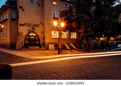 Street corner with a trail of Light in Wernigerode summer evening