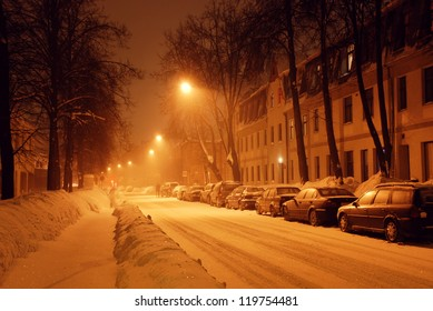 Street covered with snow at night