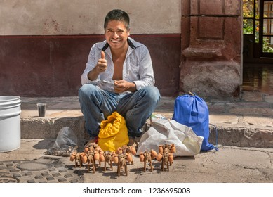 Street craft vendor in Mexico This craftsman creates small wooden mules as decoration purposes
