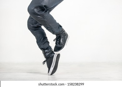 street dance in jeans and sneakers on white background