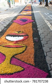 Street decorated with colored sawdust carpet for the procession of Corpus Christi. Piraju. Brazil