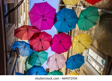 Street decorated with colored umbrellas, Avignon, France