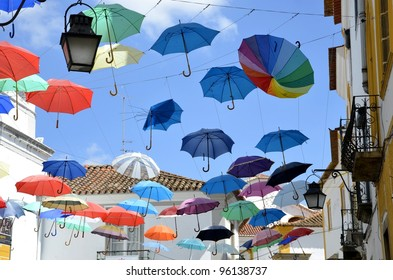 Street decorated with colored umbrellas. Evora. Portugal.