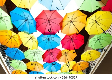 Street decoration with colorful open umbrellas hanging over the alley. Kosice, Slovakia